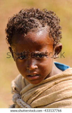 OMO VALLEY, ETHIOPIA - SEP 20, 2011: Unidentified Ethiopian little boy in Ethiopia, Sep.20, 2011. People in Ethiopia suffer of poverty due to the unstable situation