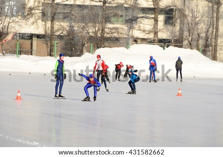 "OMSK, RUSSIA - JANUARY 2016: Stadium ""Red Star"" - children starts in speed skating."