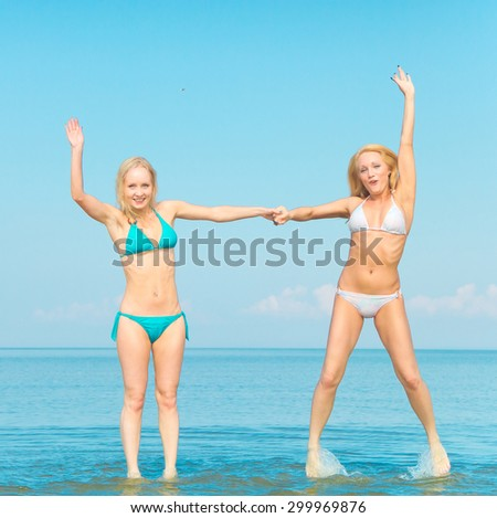 On a Beach Pleasure Models  - stock photo