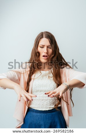 on a gray background young girl gestures and speaks - stock photo