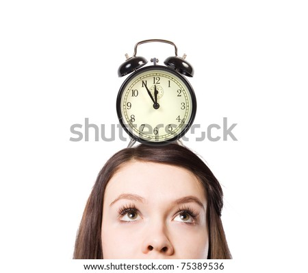 On a head of the girl there is an alarm clock.