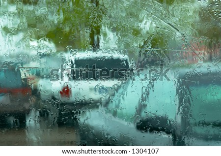 On a spring raining day, even a parking lot becomes interesting. Can also be a nice background image. This is a photo from A Raining Day Collection. Search keyword Series005 for more photos - stock photo