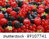 On a table there are strawberries, bilberries, red currants, raspberries and blackberries - stock photo