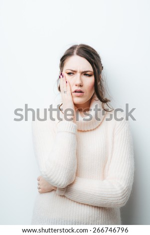 on a white background girl in a toothache - stock photo