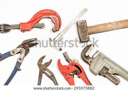 on a white background there are work tools such as cutters, pipe cutter, hammer, caliper, parrot nose pliers