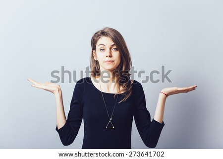 on a white background young girl throws up his hands - stock photo