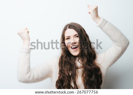 on a white background young girl with long hair rejoices - stock photo