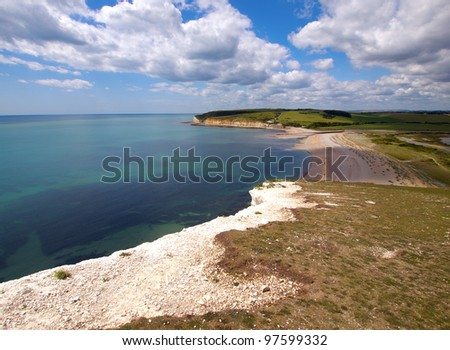On a white cliff, can see the coastal line. - stock photo