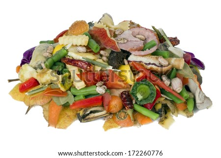 On a white table lies a heap of rotten food waste closeup concept - stock photo