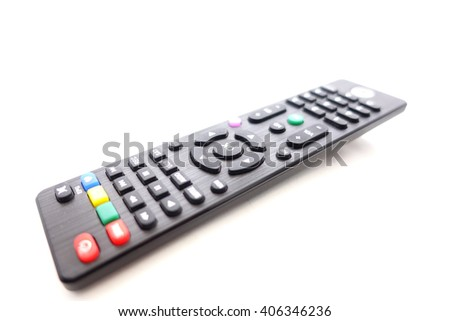On button on Tv remote control on white background:Close up,select focus with shallow depth of field - stock photo