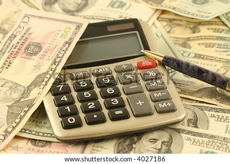 On dollar denominations of various advantage the handle and the calculator lays. - stock photo