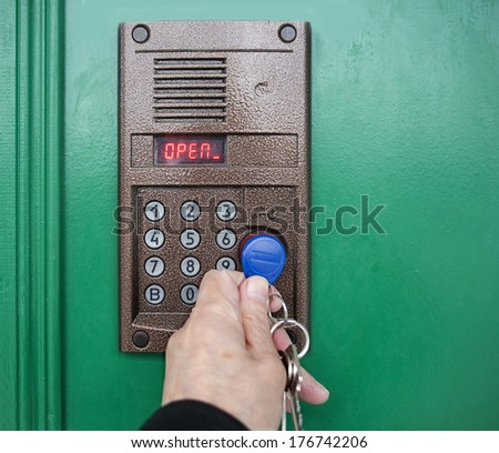 On-door speakerphone. Door opening by means of the electronic chip. - stock photo