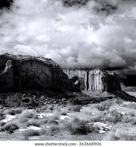 On film grain apparent Monument Valley Arizona with evening cloudy skies - stock photo