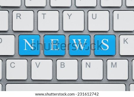 On-line news concept, close up of modern keyboard with blue news text - stock photo