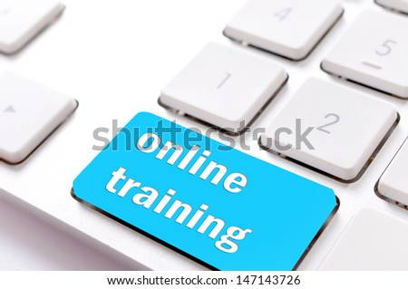 On line training sign on the keyboard - stock photo