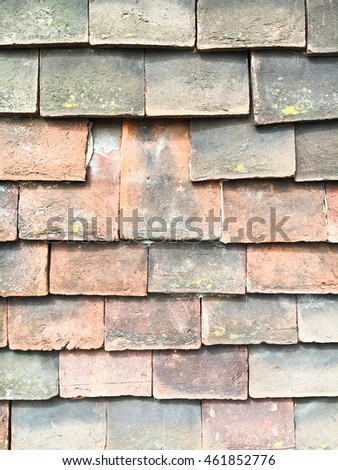On old tiled roof with a missing tile