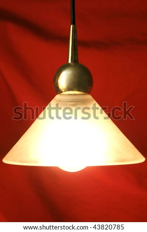 on pendent lamp on red background