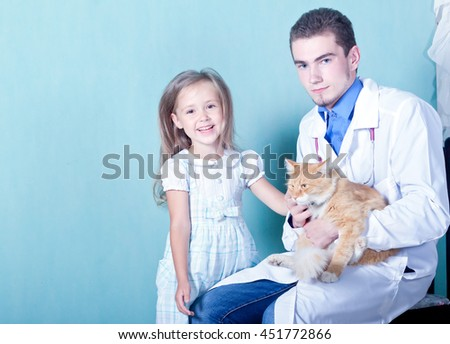on reception at the vet.Happy little girl stroking her cured the cat that sits on a man's hands vet - stock photo