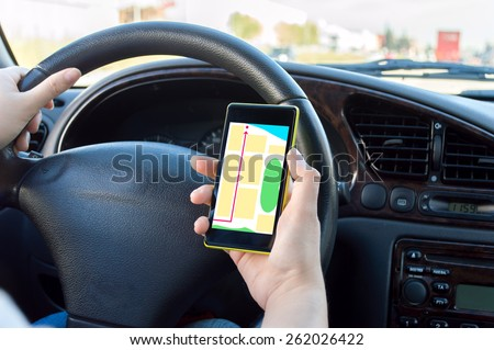 on route to her destination with gps guide with cellpphone - stock photo