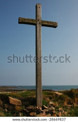 On St Cuthberts isle a wooden cross on a hill on Holy Island in Northumberland UK. - stock photo