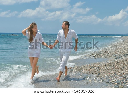 On the beach, running man and woman