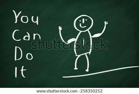 On the blackboard draw character and write You can do it - stock photo