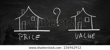 On the blackboard with chalk drawn two houses - stock photo