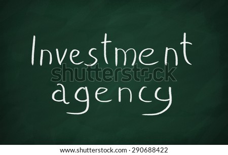 On the blackboard with chalk write Investment agency