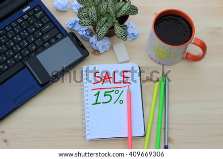On the desktop, the inscription in notepad, sales and discounts  - stock photo