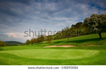 On the empty golf course in spring in Czech Republic - stock photo