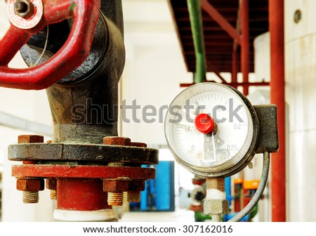 On the factory floor of a pressure gauge and valve - stock photo