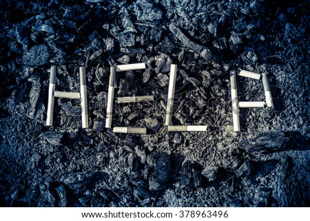 "On the ground, scattered coals (ash). On the coals of cigarettes lined inscription ""help""."
