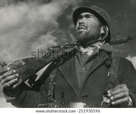 On the Guadalajara front, a soldier of the Spanish Republican (loyalist) army looks out for airplanes. April 1937. Spanish Civil War, 1936-1939. - stock photo