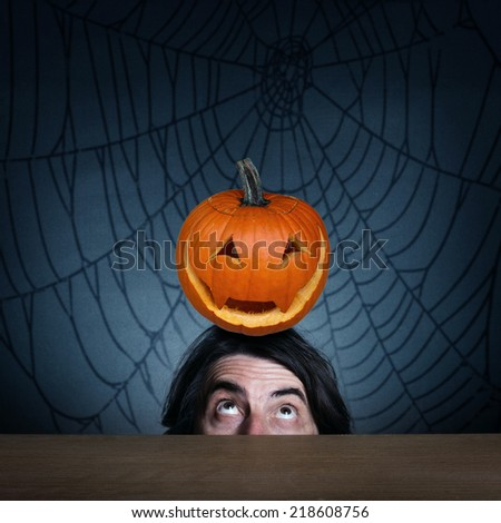 On the head of the man is the pumpkin.The concept of holiday Halloween. - stock photo