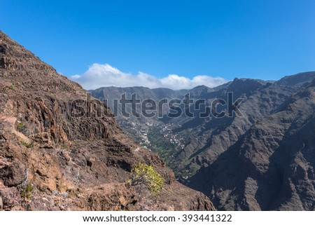 On the long distance hiking trail from the Valle Gran Rey to the village Arure in the highlands of the Canary island La Gomera. 850m high on serpentine to the La Merica plateau on top of the mountain - stock photo