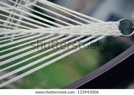 on the metal ring is stretched braided white rope