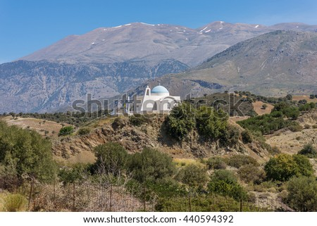 On the old road to Rethymno. White greek orthodox church in the foothills of the Ida Mountains on Crete. In the Background the Psiloritis, the highest mountain on the island. - stock photo