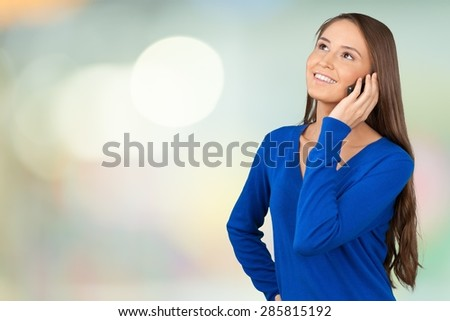 On The Phone, Mobile Phone, Women. - stock photo