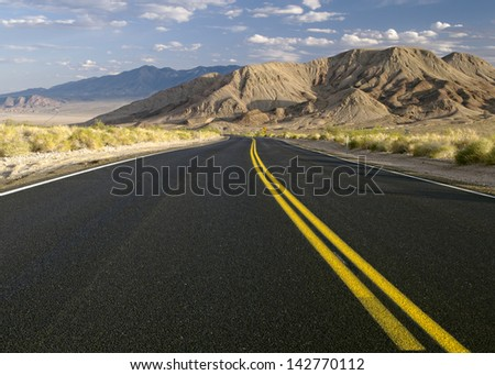 On The Road. Desert road, State Rouite 127 near the Ibex Pass, Inyo County, California, USA. - stock photo