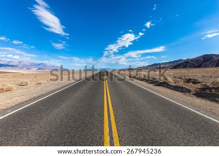 On the road landscape of the route crossing the Death Valley - stock photo