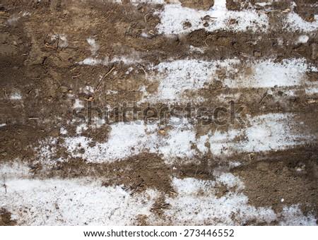 on the white snow mud - stock photo