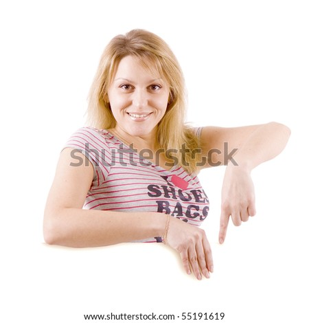 On white background the smiling young woman behind the white stand - stock photo