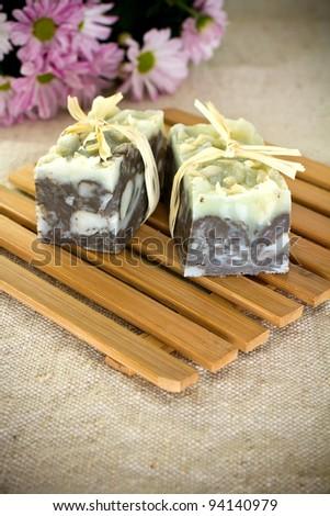 On wooden mats natural soap, handmade. - stock photo