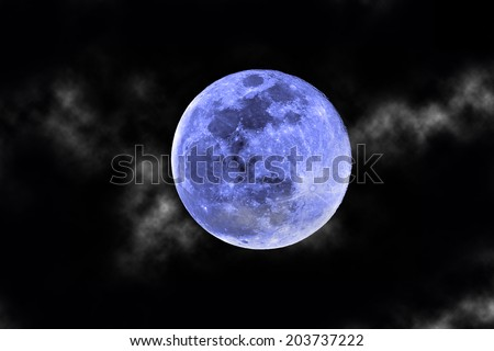 once in a blue moon with clouds - stock photo