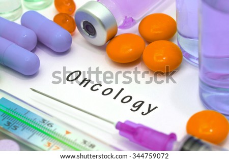 Oncology - diagnosis written on a white piece of paper. Syringe and vaccine with drugs - stock photo
