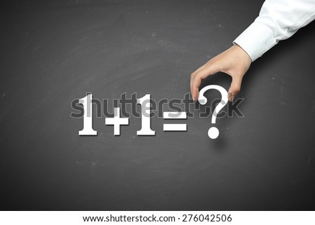 One add one equal question mark with businessman hand holding against blackboard background. - stock photo