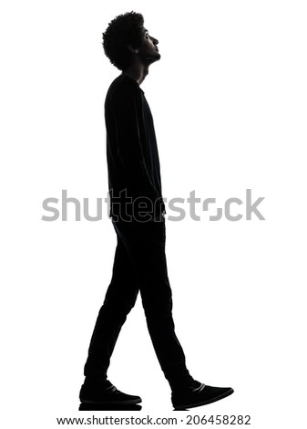 one african handsome young man walking looking up in silhouette studio isolated on white background