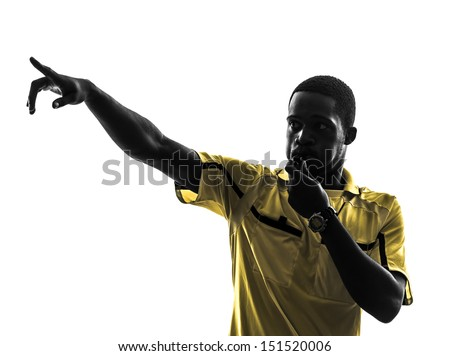 one african man referee whistling pointing in silhouette  on white background - stock photo