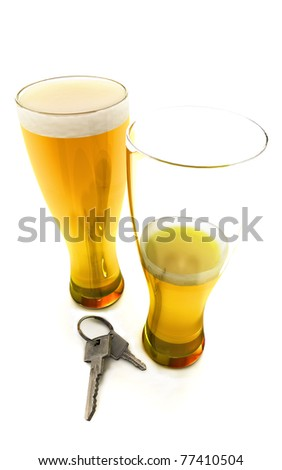One and a half beers with car keys isolated on a white background, 300 D.P.I - stock photo
