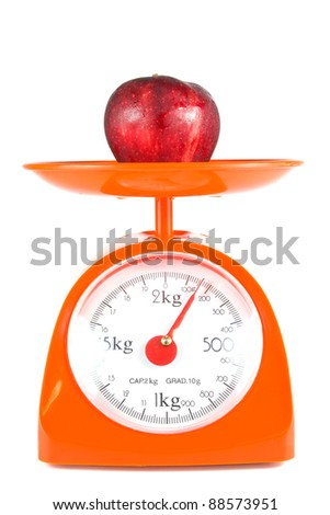 one apple lying on weight scale - stock photo